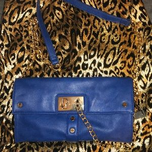 Royal blue purse with gold chain details